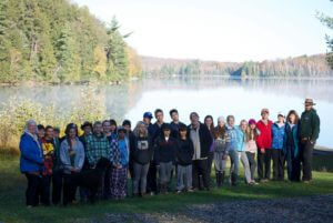 students and staff pose lakeside at the Haliburton Forest Reserve during a team-building experience organized by King's College School, a private school serving students in the Caledon, Brampton, Orangeville and Bolton areas.