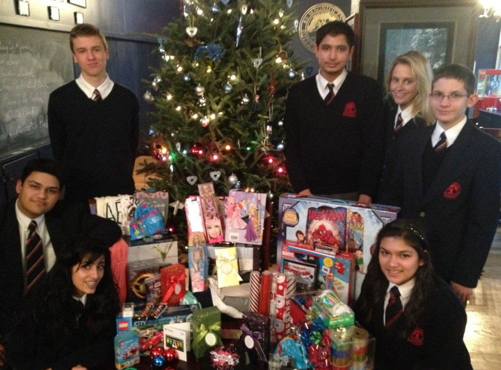 students posing with donated items received as part of the Christmas Families series of fundraisers organized by students from King's College School, a private school serving students in the Caledon, Brampton, Orangeville and Bolton areas