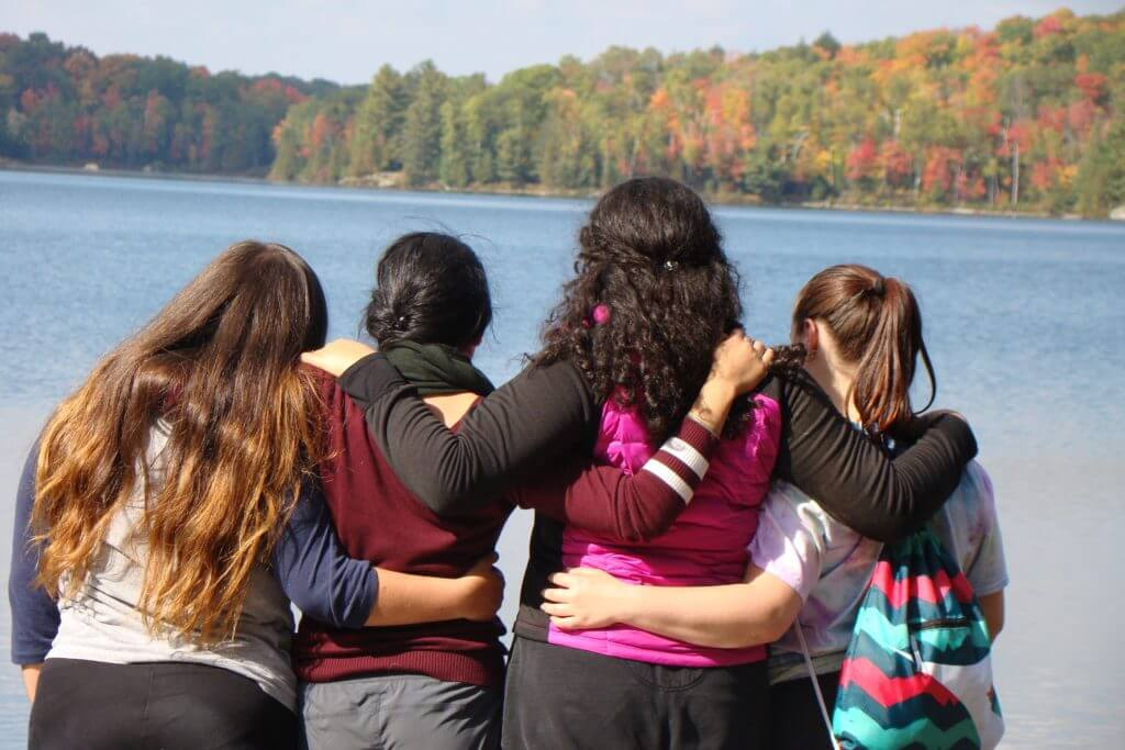 students taking in the lake view at the Haliburton Forest Reserve during a team-building experience organized by King's College School, a private school serving students in the Caledon, Brampton, Orangeville and Bolton areas.